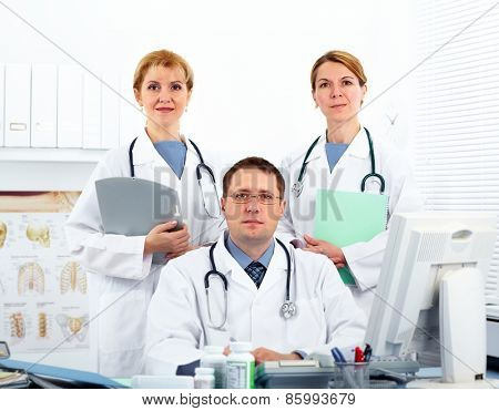 Group of Medical doctors in health care clinic.