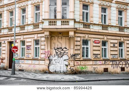 Historical building with walls painted in graffiti