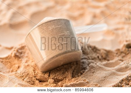 Whey protein scoop. Sports nutrition for muscle power.