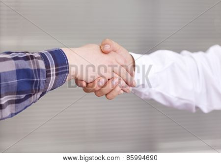 Handshake between doctor and patient