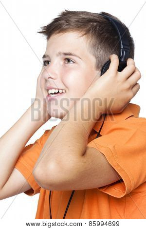 Close-up of a smiling boy with headphones listening to music, isolated on white background