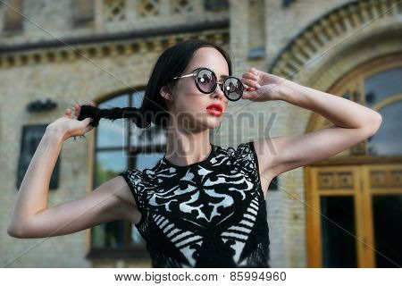 Fashion woman with red lips in sunglasses
