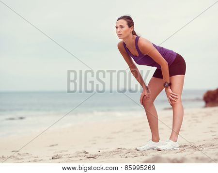 Sporty young woman on the sea coast
