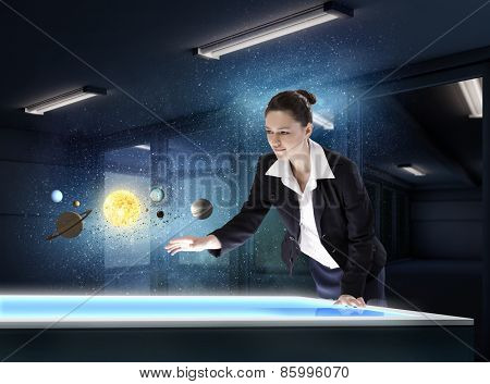 Young businesswoman and planets of space spinning around