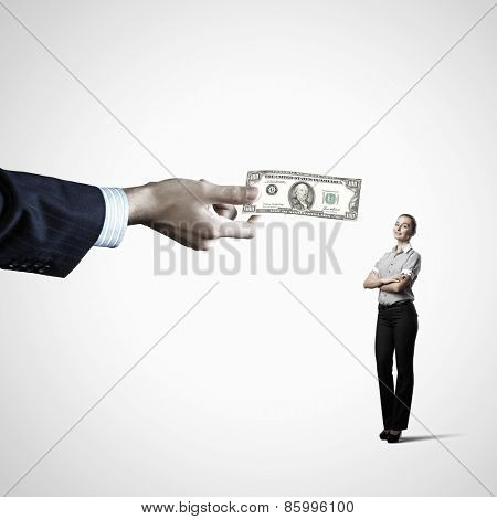 Close up of hand giving money to businesswoman