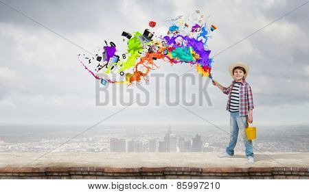 Boy of school age with yellow bucket and paint brush