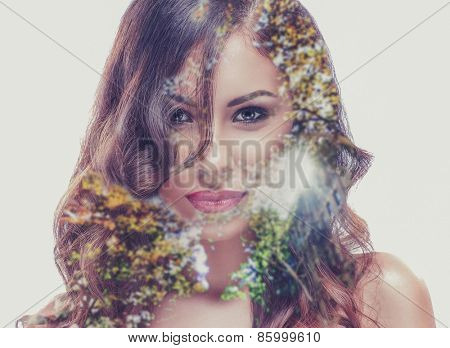 Double exposure of a beautiful girl and a tree
