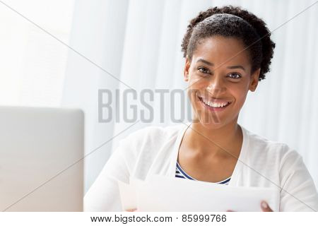 Businessowman working with papers in office