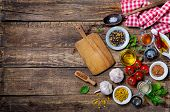 picture of ingredient  - Ingredients for cooking and empty cutting board on an old wooden table - JPG