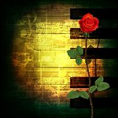 picture of sax  - abstract green grunge music background with red rose - JPG