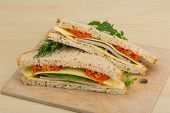 image of tomato sandwich  - Club sandwich with sausages tomato and cheese - JPG