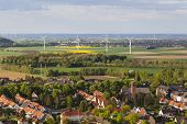stock photo of west village  - Flat west German landscape near Aachen and Herzogenrath with wind turbines behind a small village - JPG