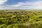 stock photo of west village  - Flat west German landscape near Aachen and Herzogenrath with lots of wind turbines and a village in the foreground - JPG