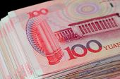 stock photo of yuan  - A stack of one hundred renminbi (RMB) or yuan currency.