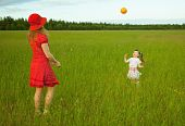 Mum And Daughter Play With A Ball