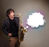 foto of saxophone player  - Handsome young man playing on saxophone with copy space in white cloud - JPG