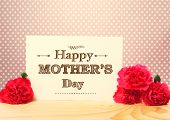foto of carnations  - Mothers Day Card with Carnation Flowers on Top of a Wooden Table - JPG