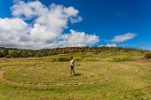 pic of woman dragon  - Woman doing walking meditation in labyrinth near Dragon - JPG