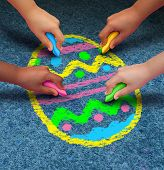 image of arts crafts  - Easter arts and crafts concept as a group of children with chalk drawing a decorated egg on an asphalt texture as a symbol for cooperation and fun seasonal activities for kids - JPG