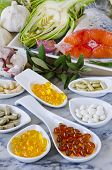 image of naturopathy  - Variety of dietary supplements including capsules of Garlic Evening Primrose Oil - JPG