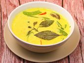 stock photo of curry chicken  - Hot and spicy chicken green curry on a wood table top - JPG