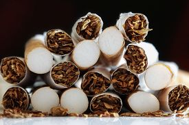 stock photo of bans  - Broken cigarette ends in a heap concept for quitting smoking and healthy lifestyle - JPG
