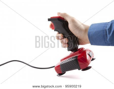 Computer joystick with hand isolated on white. Clipping path included.