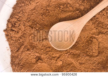 Cocoa Powder And Wooden Spoon From Above - Close Up Of Textured Background