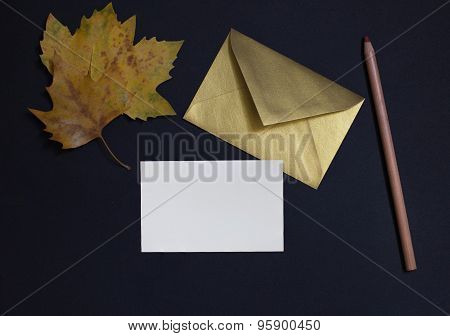 Autumn Leaf On Black Background With Card Invitation And Golden Envelope