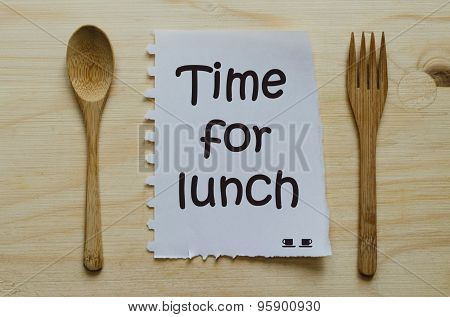 Time for lunch written on note between spoon and fork
