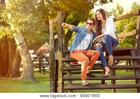 Modern fashion couple of young lovers in the park
