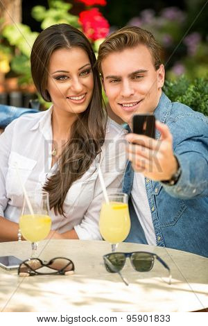 Cute couple taking selfie with smart phone