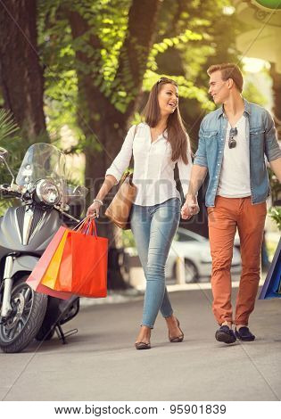 Happy young tourists couple  in shopping tour