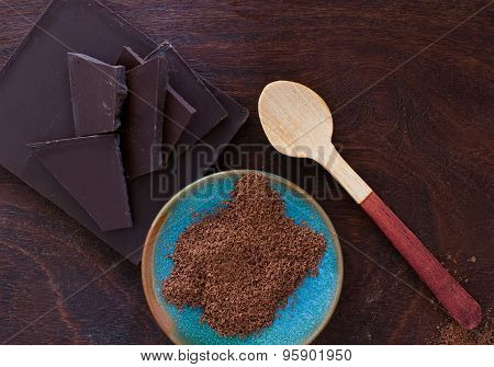 Close Up Of  A Wooden Spoon, Chocolate And Cocoa Powder On Wooden Background - Studio Shot  From Abo