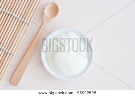 Isolated Wooden Spoon And Natural Yogurt In A Bowl - From About - Studio Shot