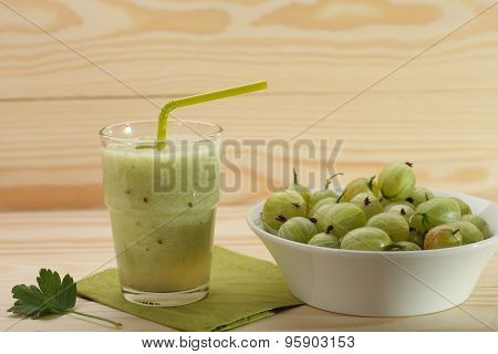 Smoothie From Gooseberries In A Glass And Gooseberries In Bowl  On Wooden Table