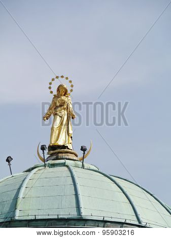 A saint on the roof in Northern Italy