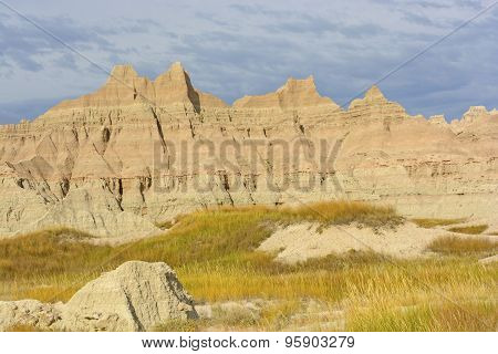 Colorful Badlands Formations Against Stormy Skies