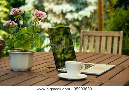 Notebook computer on garden table