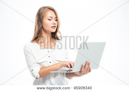 Pretty young woman using laptop isolated on a white background