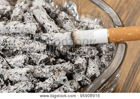 Cigarette Ashes In An Ashtray And Cigarette