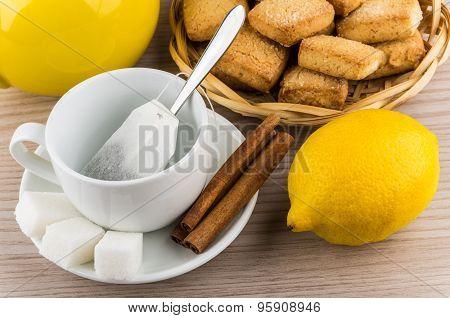 Cup With Tea Bag, Sugar And Cinnamon, Lemon And Cookies