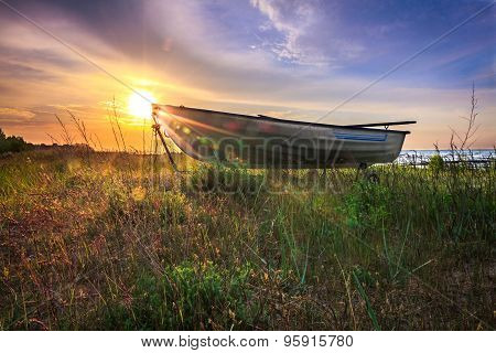 Boat In Grass With Sunrise