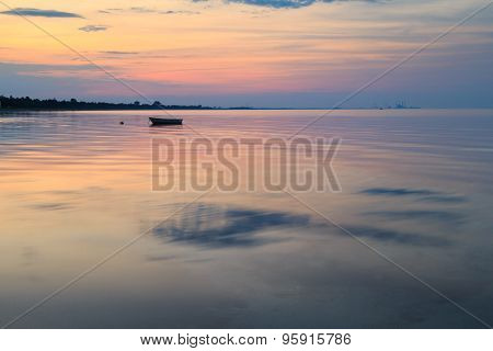 Boat In The Ocean At Sunrise