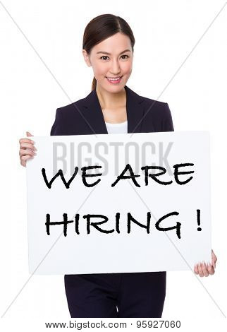 Businesswoman hold with a board showing phrase of we are hiring