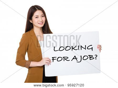 Businesswoman hold with palcard and presenting phrase of looking for a job