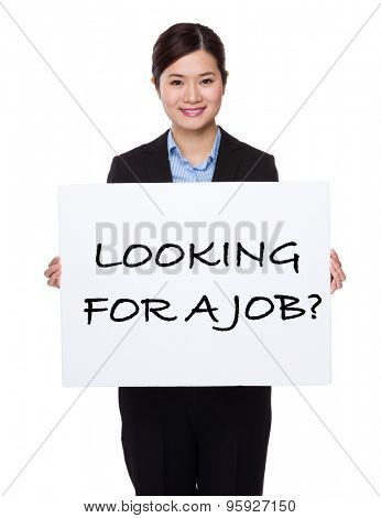 Businesswoman with white palcard for showing phrase of looking for a job