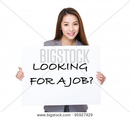 Businesswoman hand hold a white placard presenting phrase of looking for a job