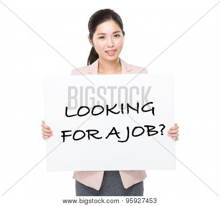 Businesswoman holding a placard showing phrase of looking for a job