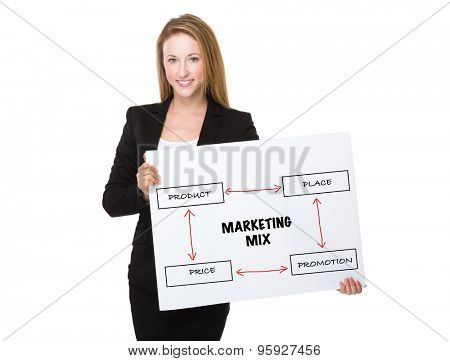 Businesswoman holding with a placard showing marketing mix concept